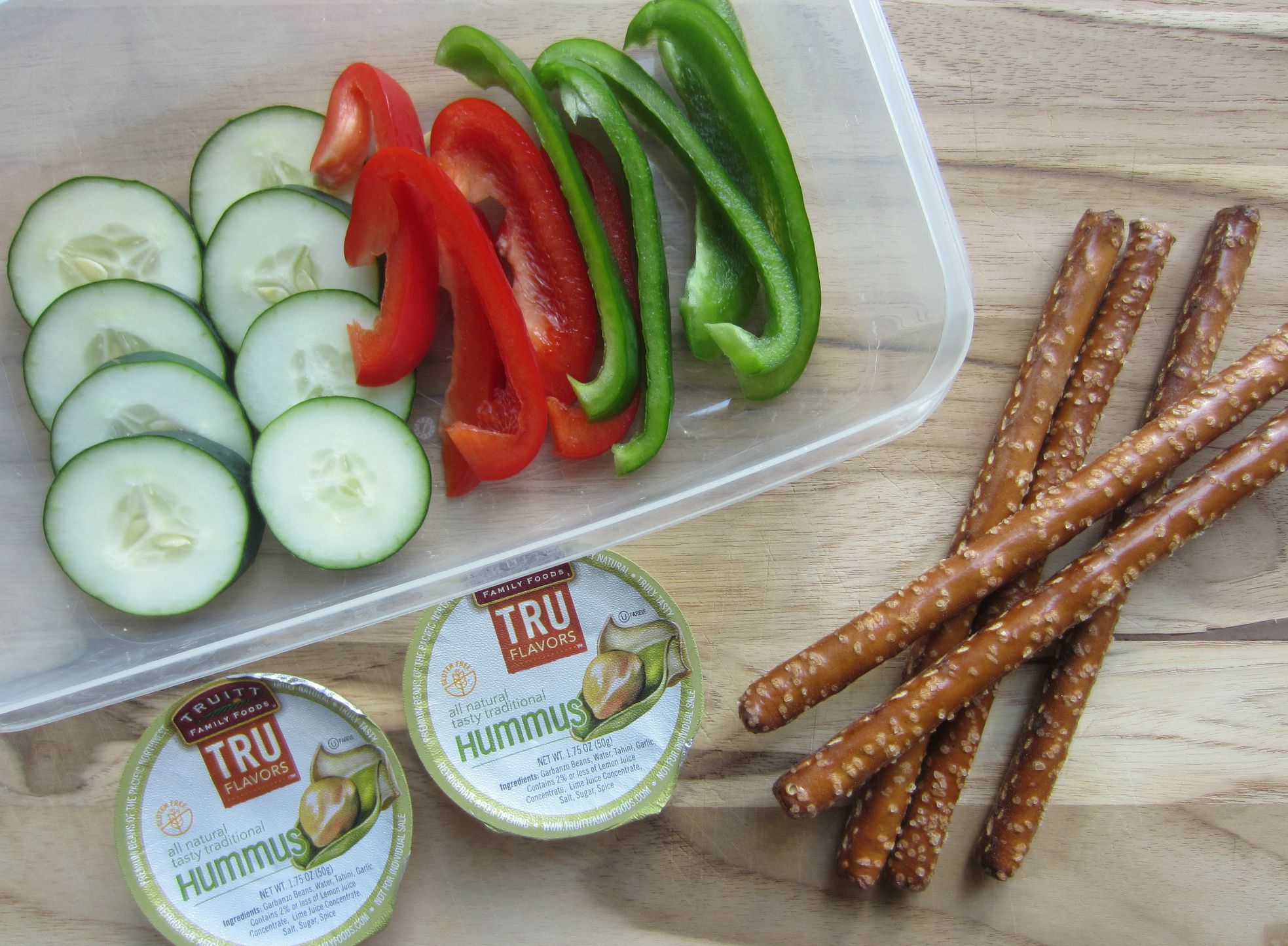healthy snacks to go - veggies and pretzels with hummus
