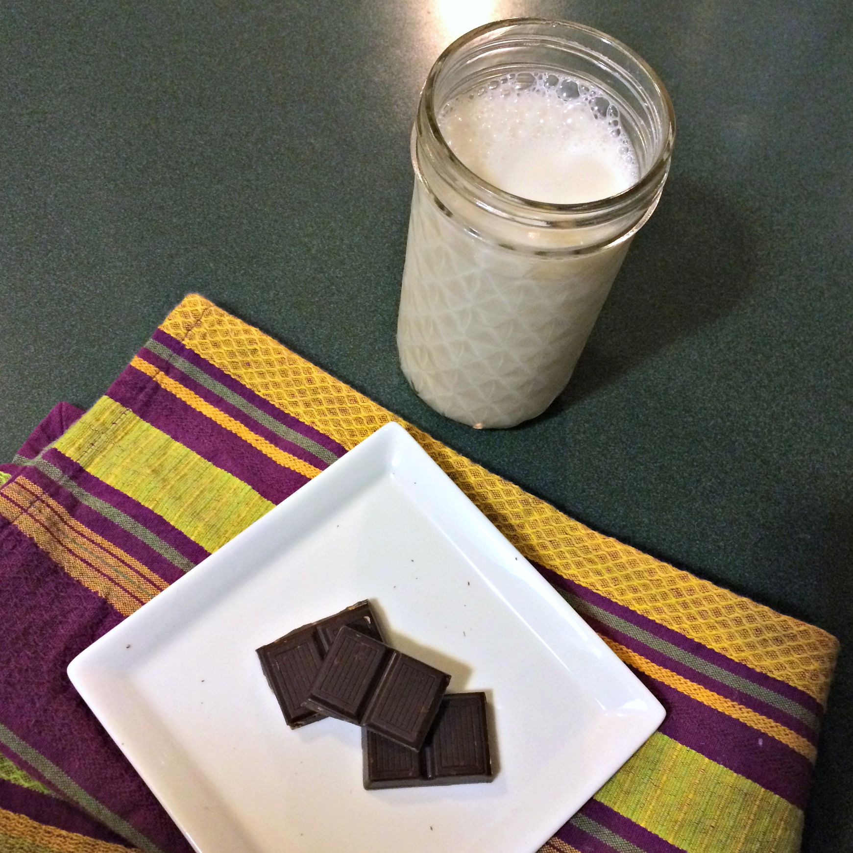 healthy dessert - dark chocolate squares and almond milk
