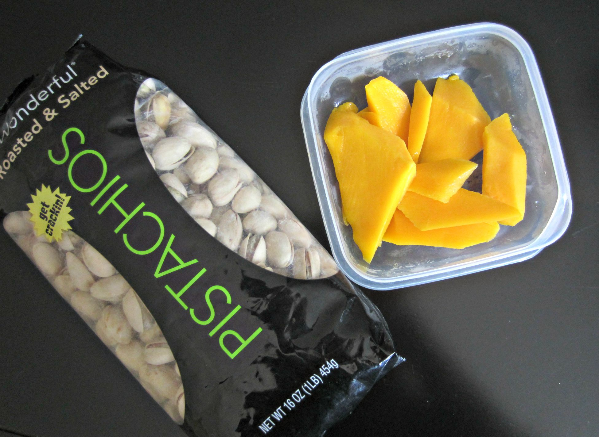 healthy snack mangoes and pistachios