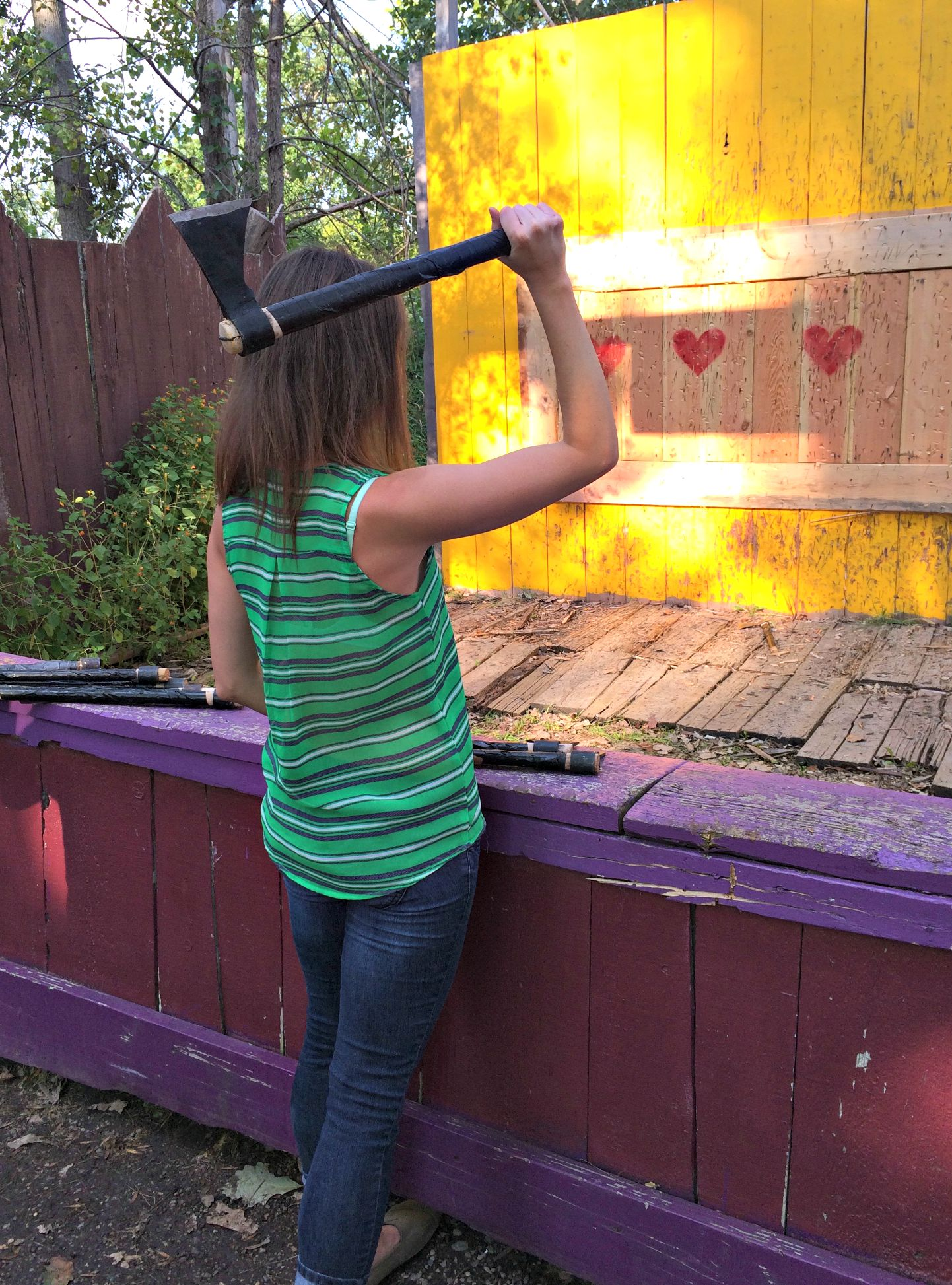 heather throwing axes at renaissance fair