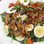 honey garlic chicken on salad with eggs