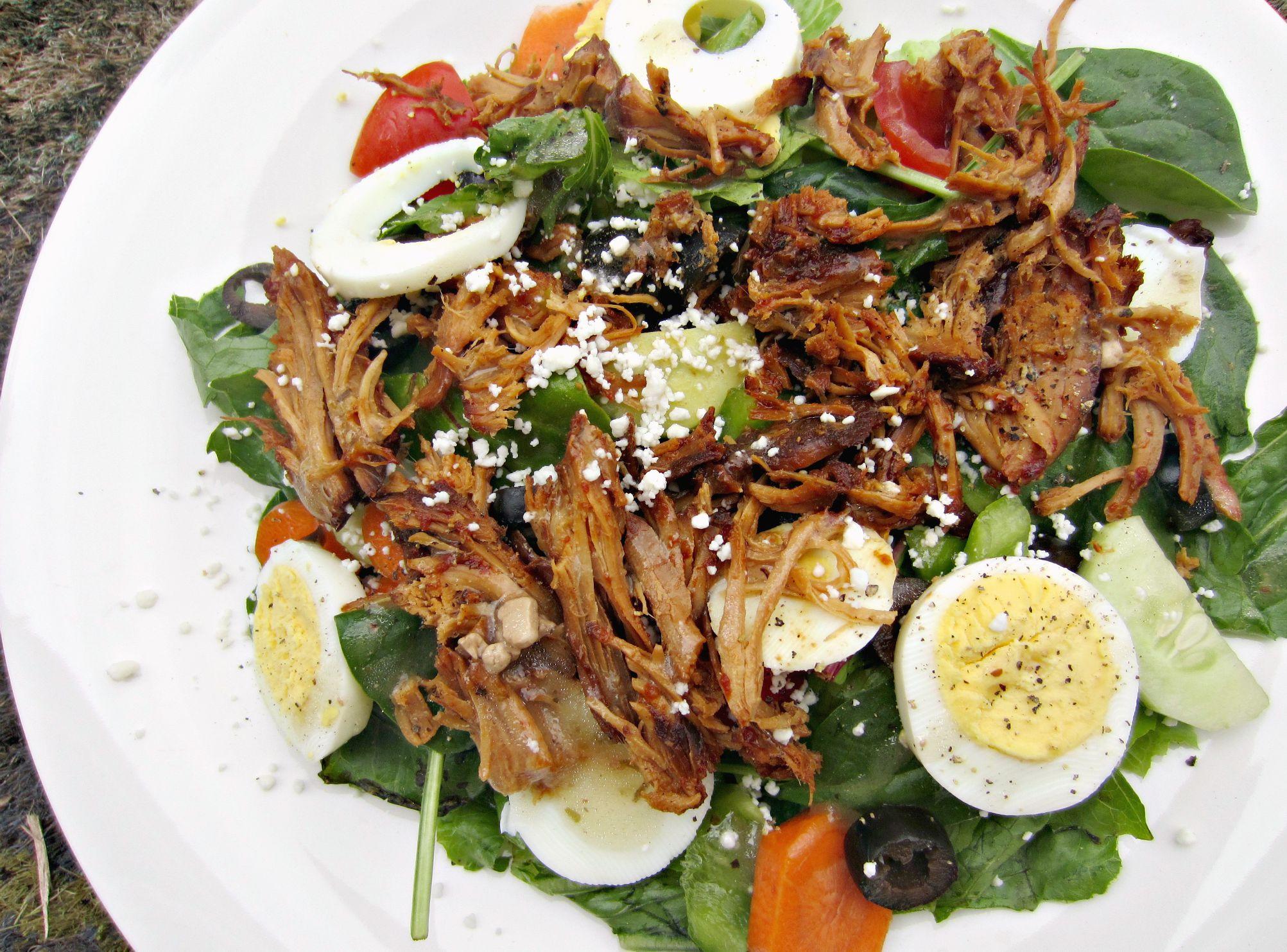 honey garlic chicken on salad with eggs