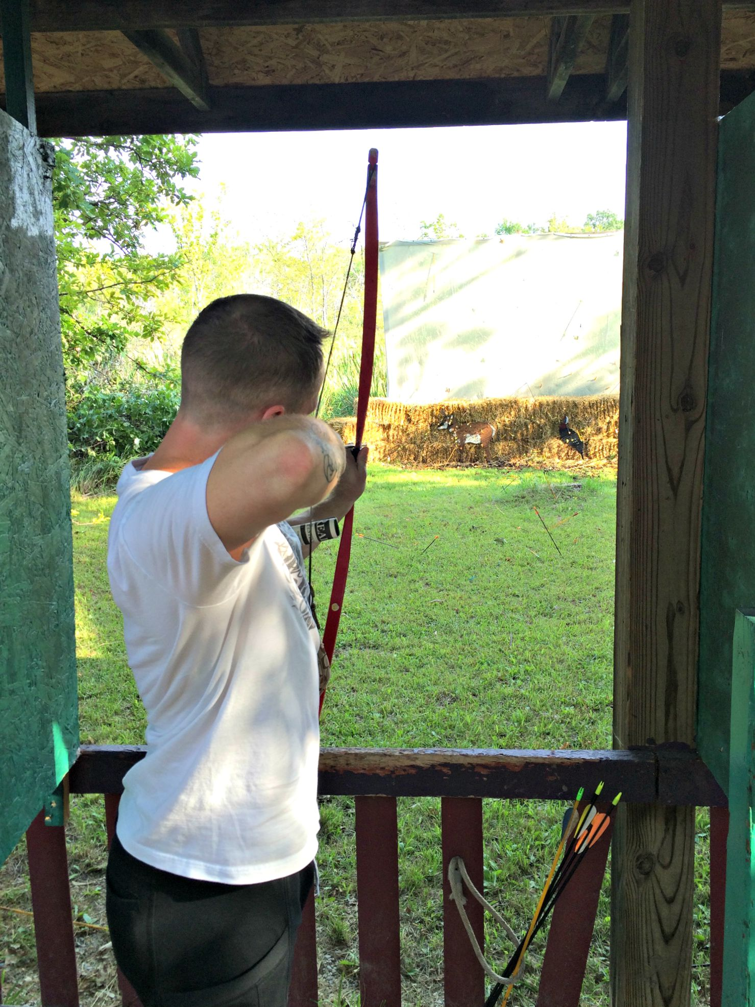 scott shooting a bow and arrow