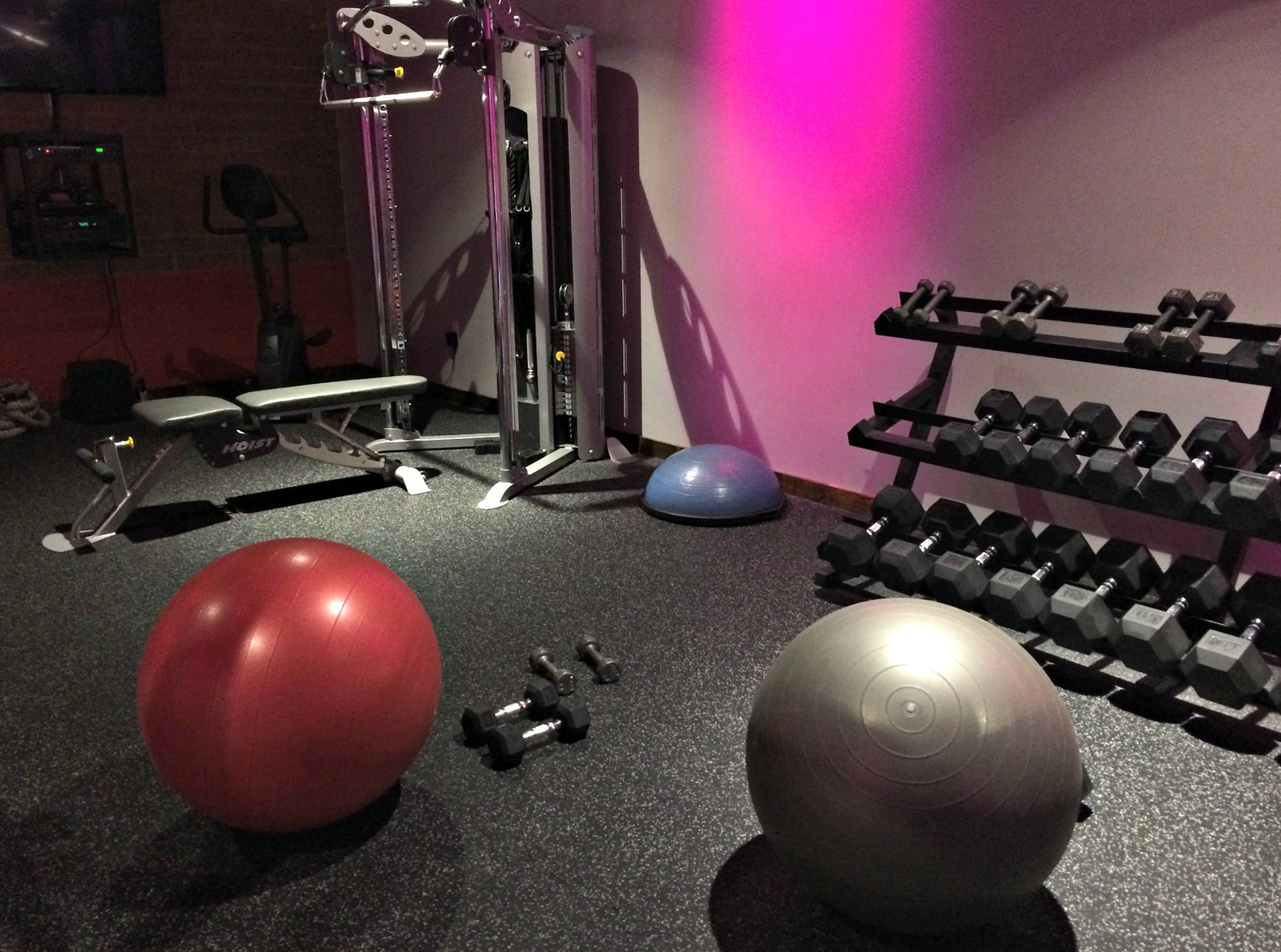 strength training workout with stability balls and dumbbells