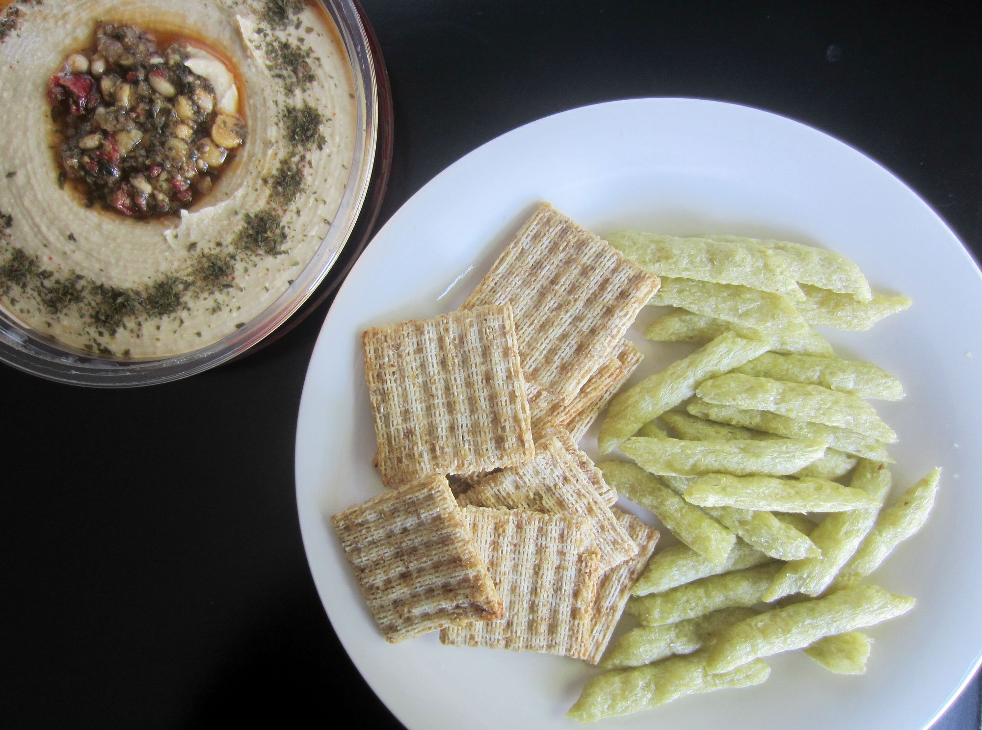 triscuits and snap pea crisps with hummus - healthy snack