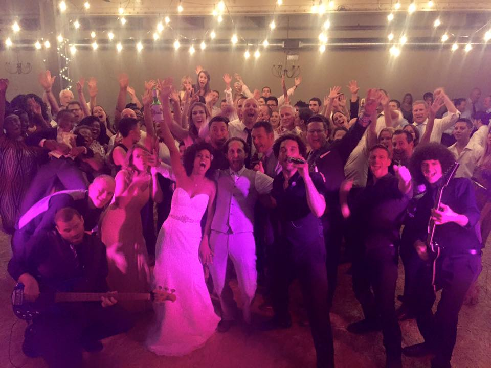 wedding group photo with one night band
