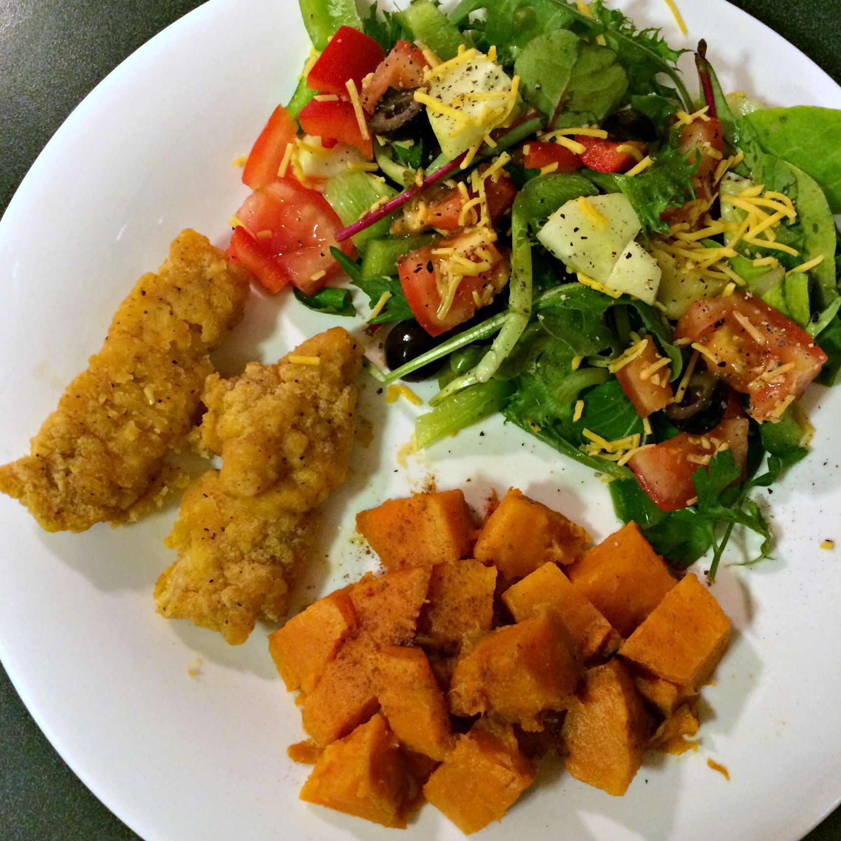 gluten free chicken tenders with salad and sweet potato