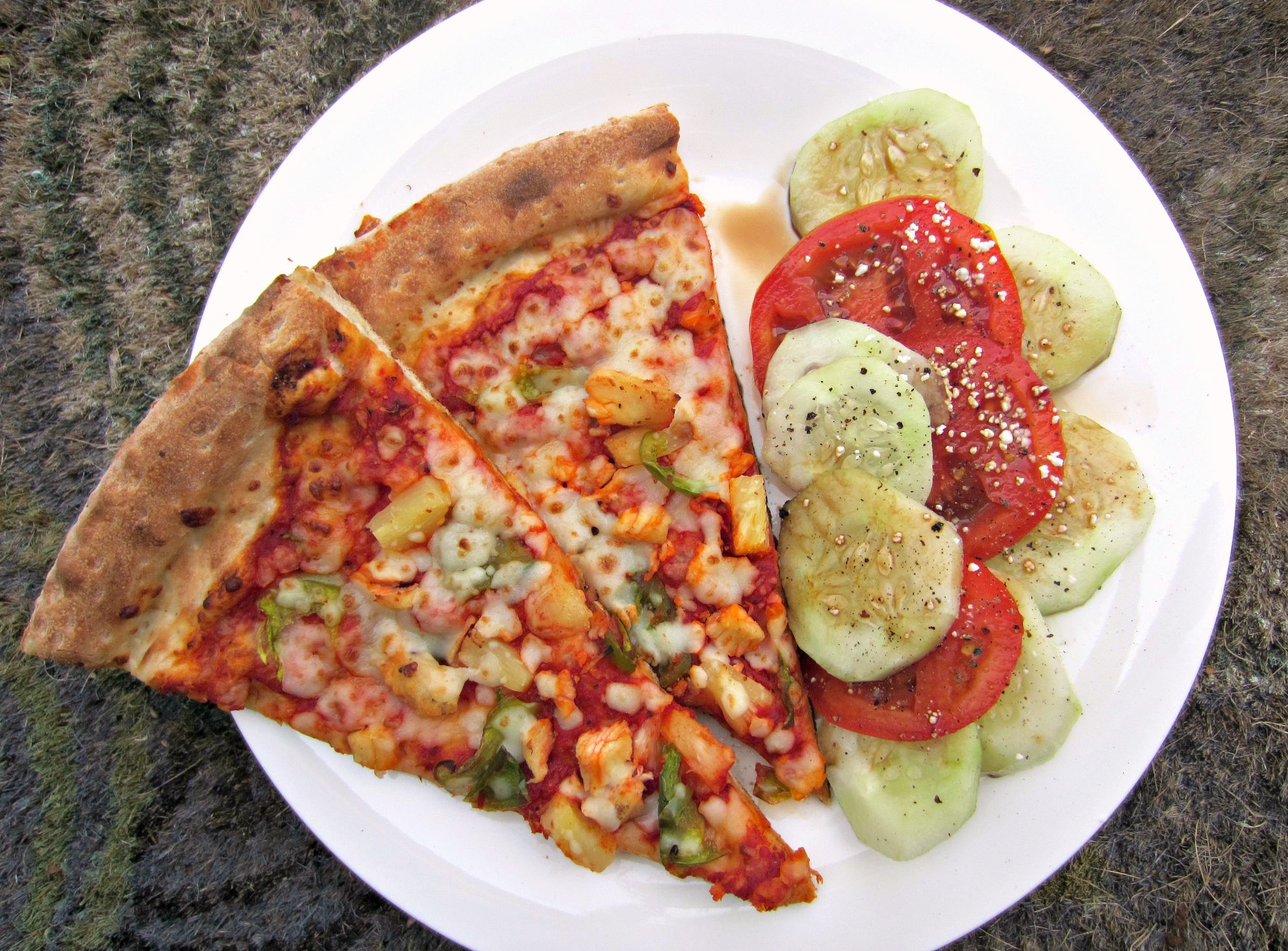 leftover pizza with cucumber and tomato salad