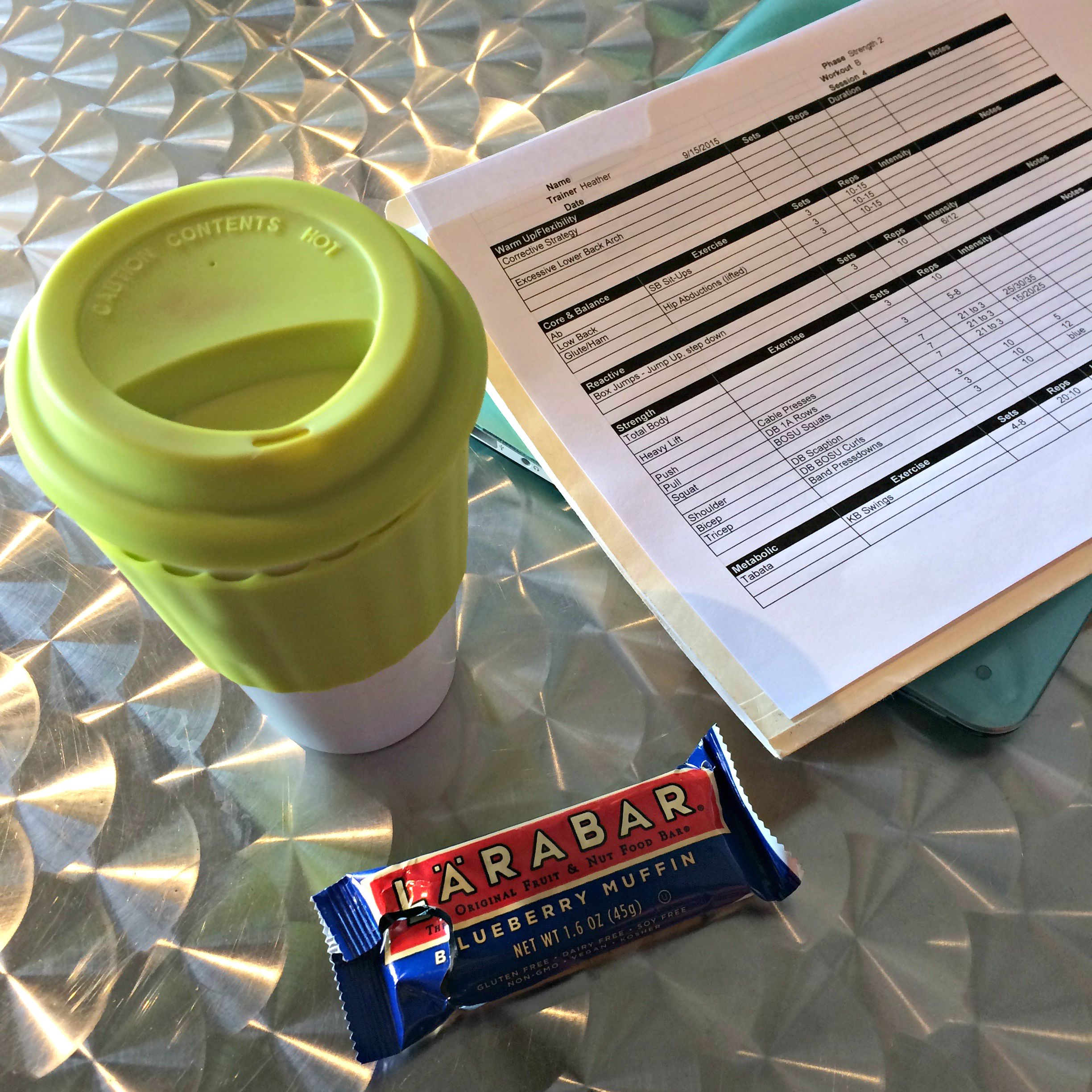 tea and blueberry muffin larabar while planning workouts