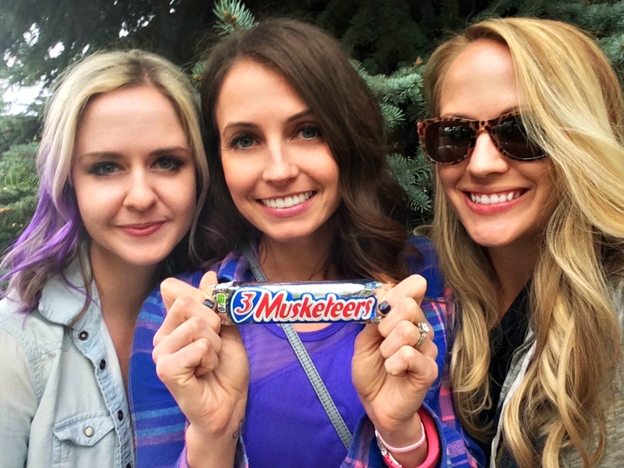 3 musketeers holding a 3 musketeers