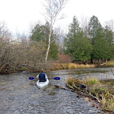 Scott kayaking down the river