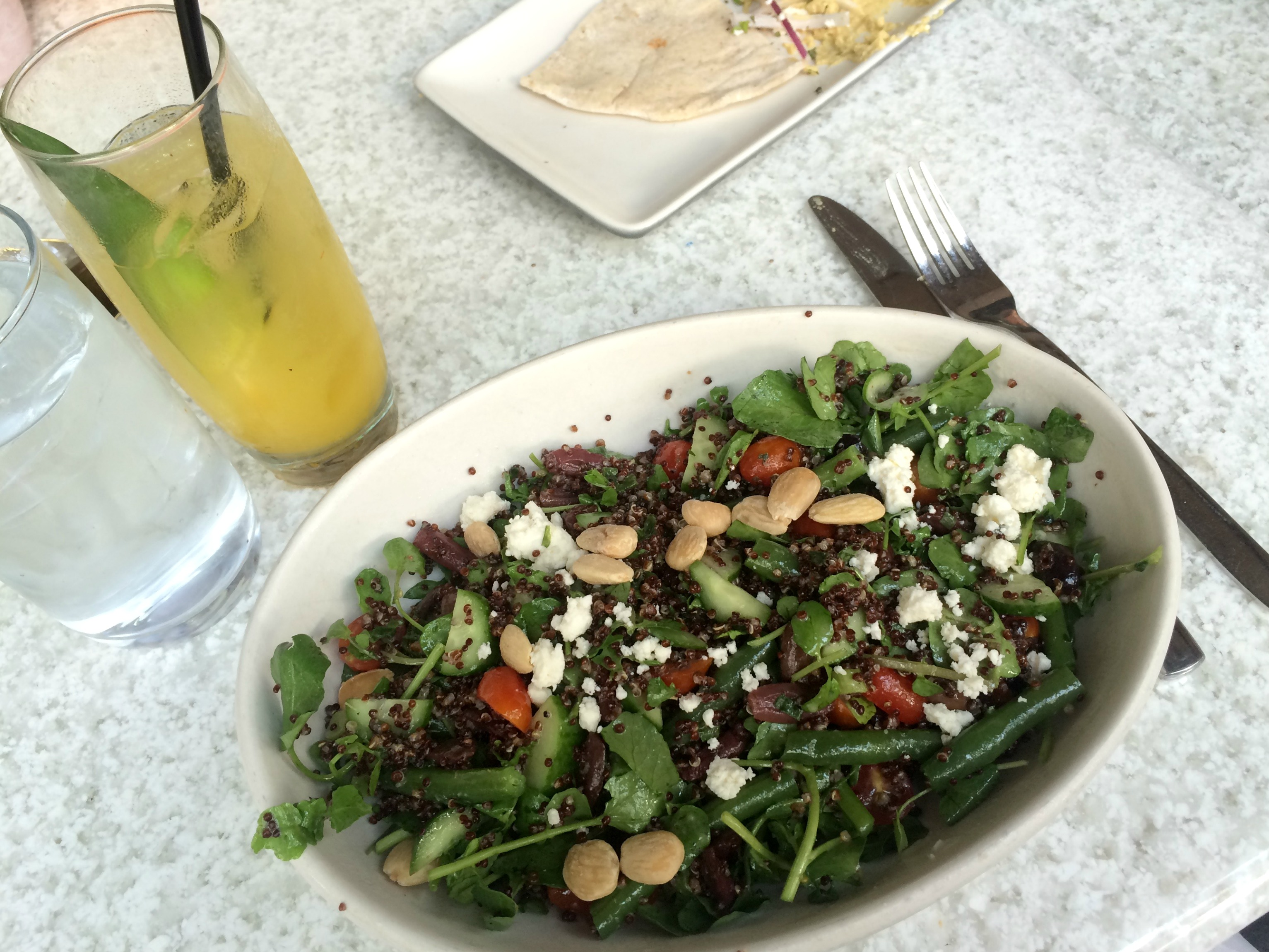 true food mediterranean salad and natural juice