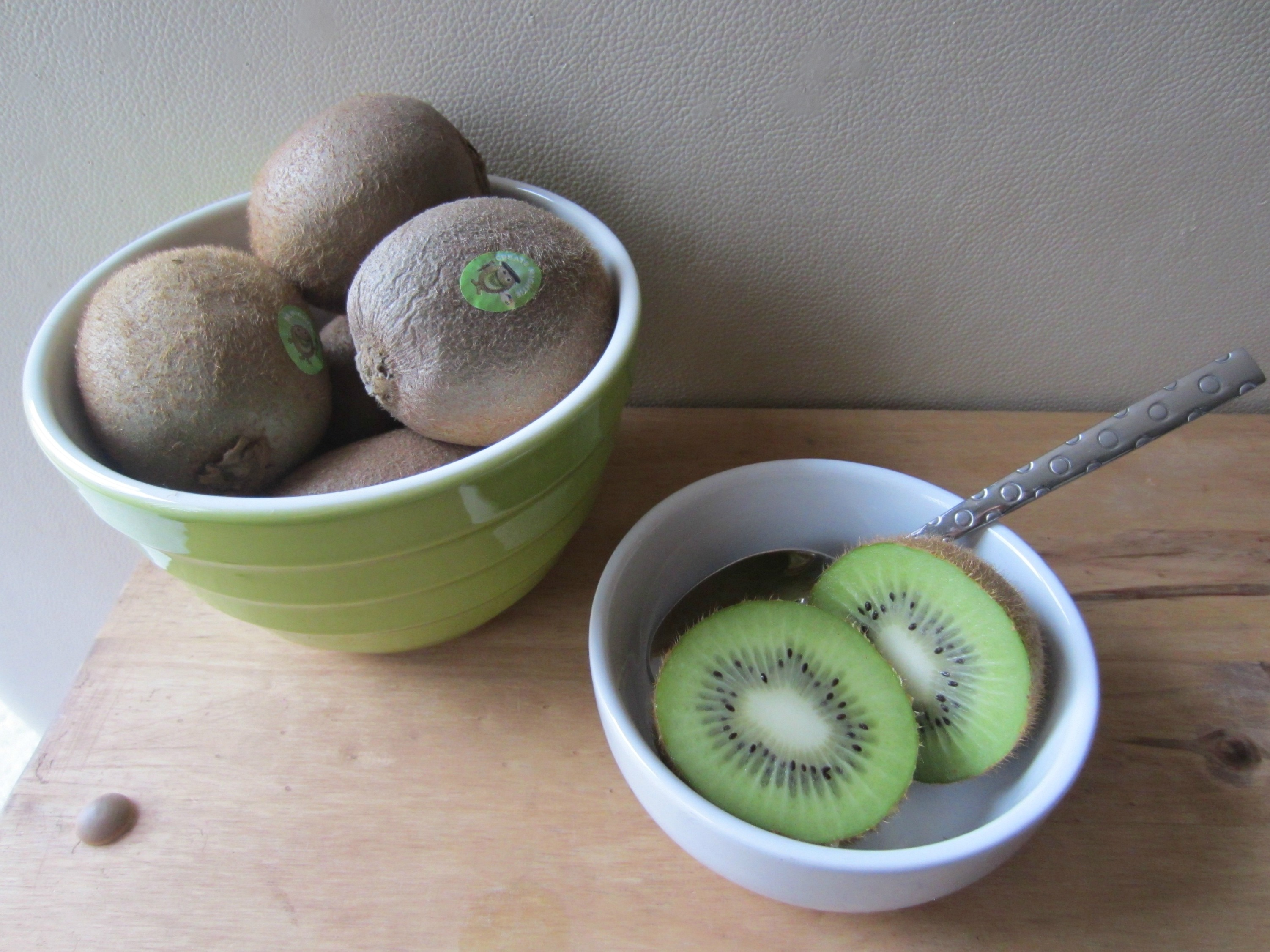 kiwis with a spoon
