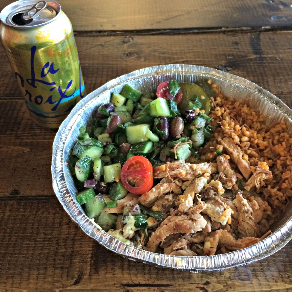 mediterranean bowl with rice, chicken, and salad