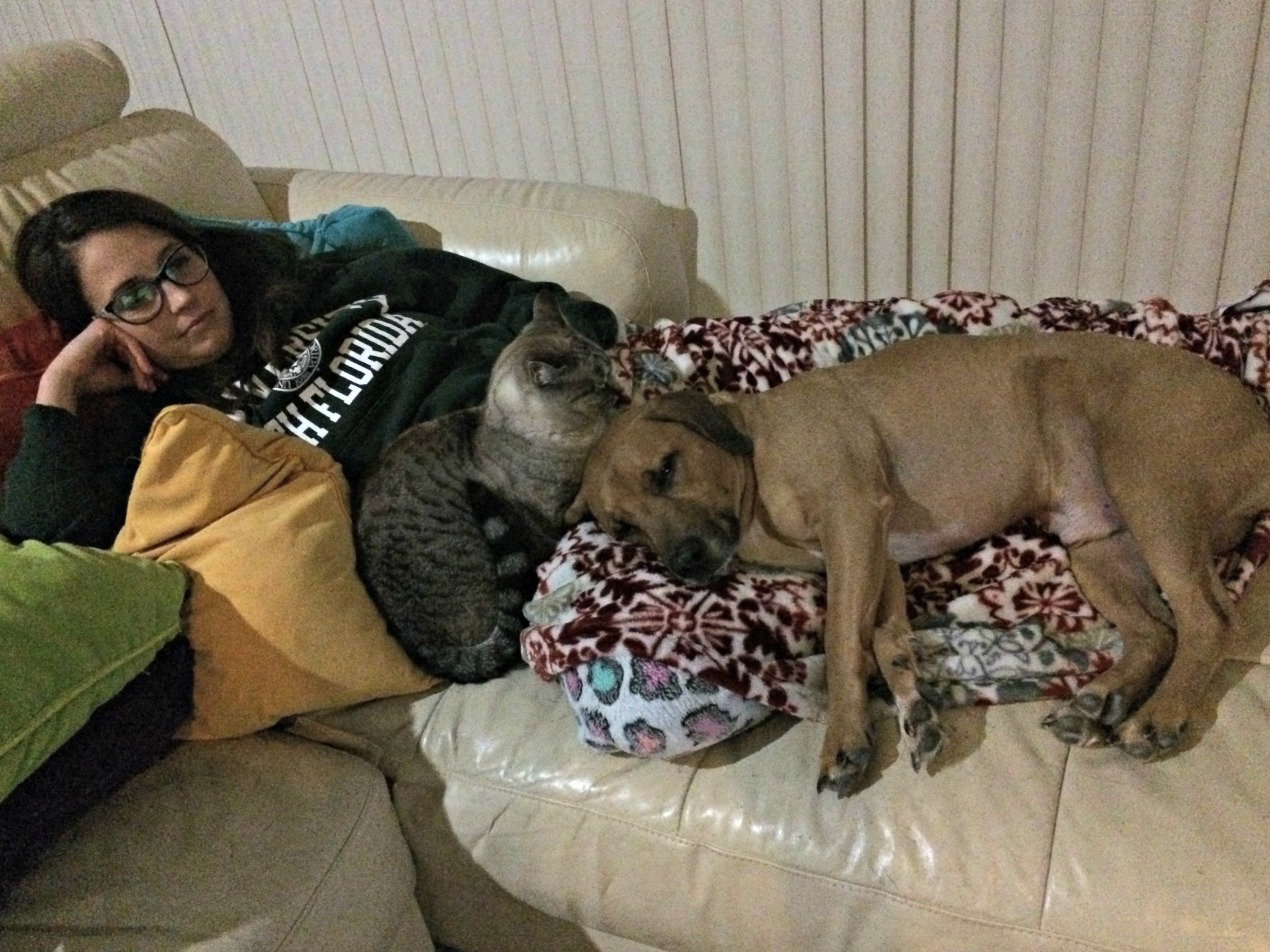 heather snuggling on couch with roadie