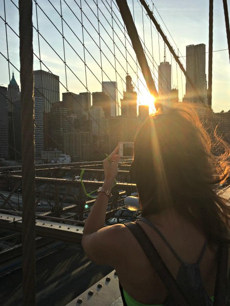 Heather taking pictures on brooklyn bridge