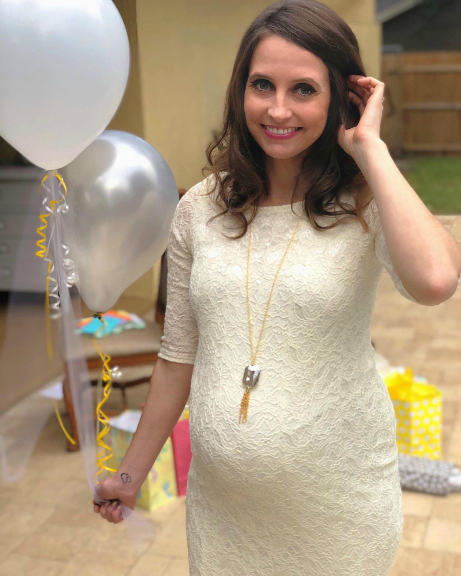 heather at baby shower pink blush maternity dress