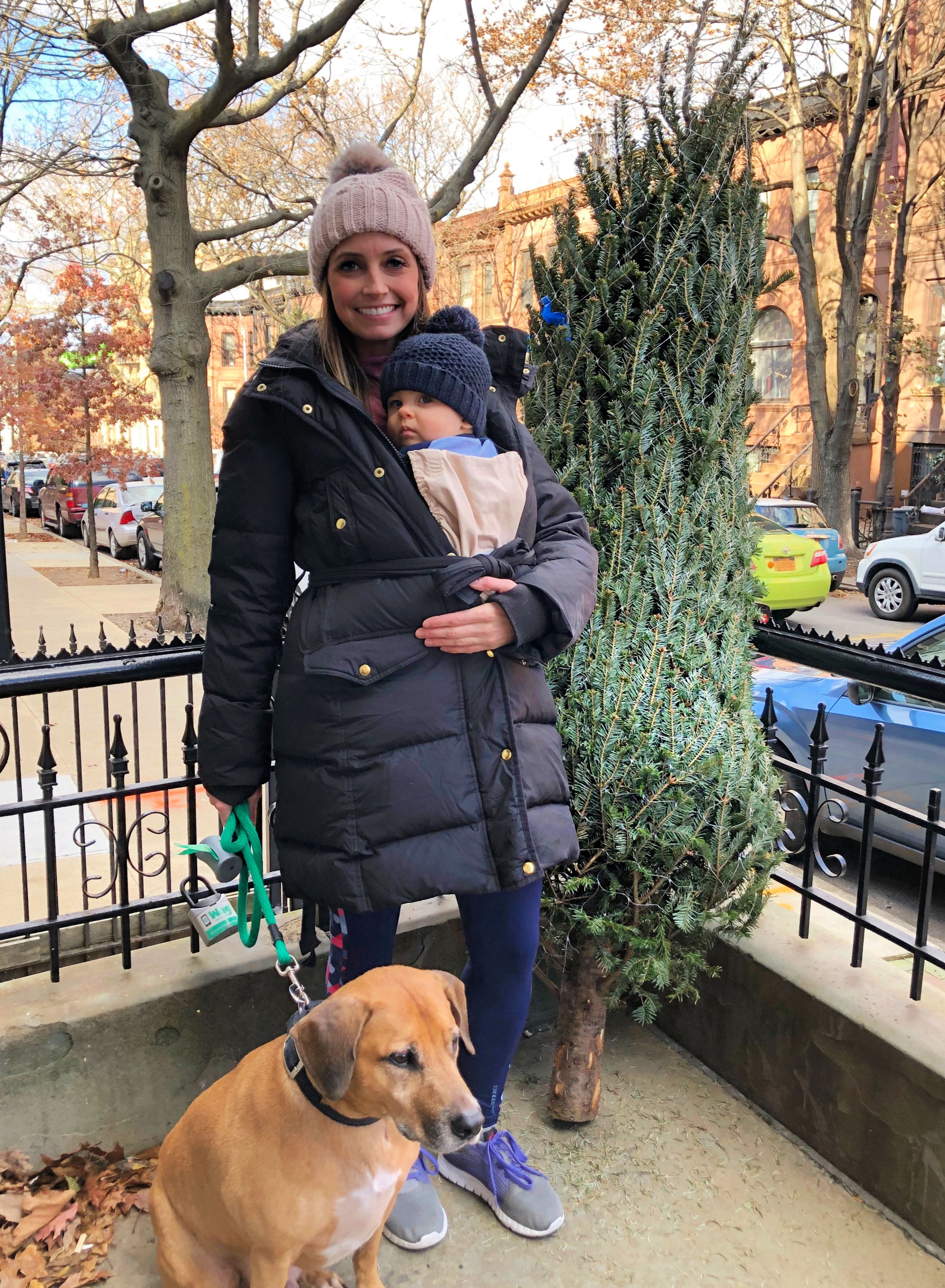heather and skyler with christmas tree 2018
