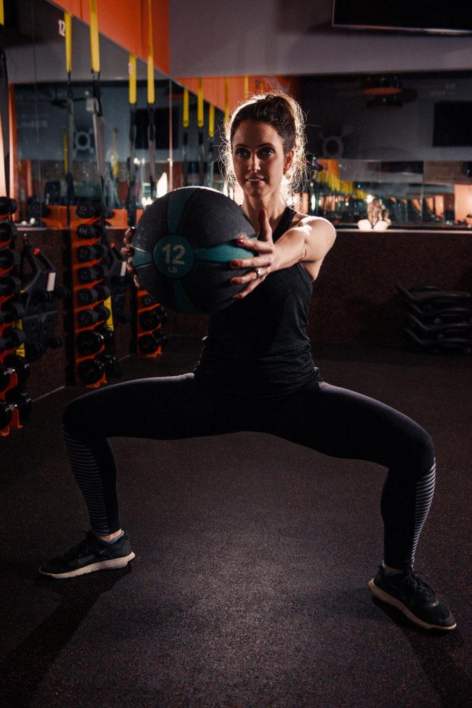 medicine ball squat - heather life in leggings