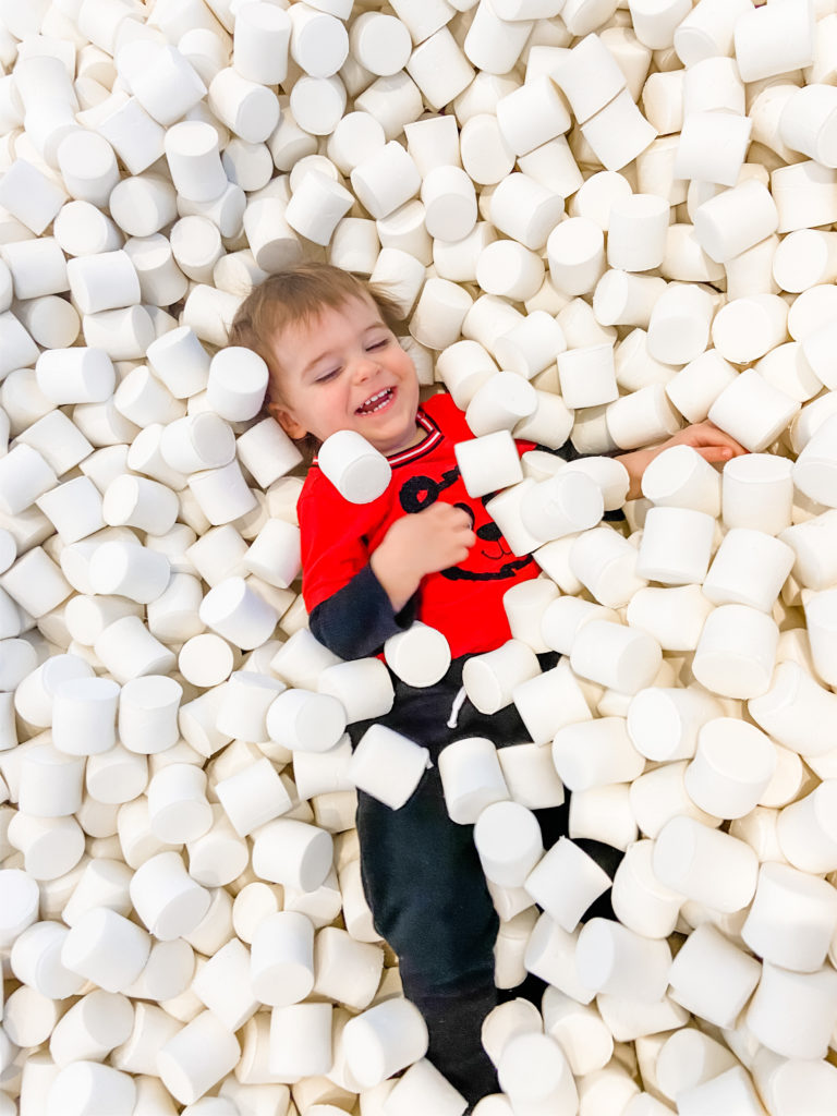 toddler retail store - skyler in ball pit