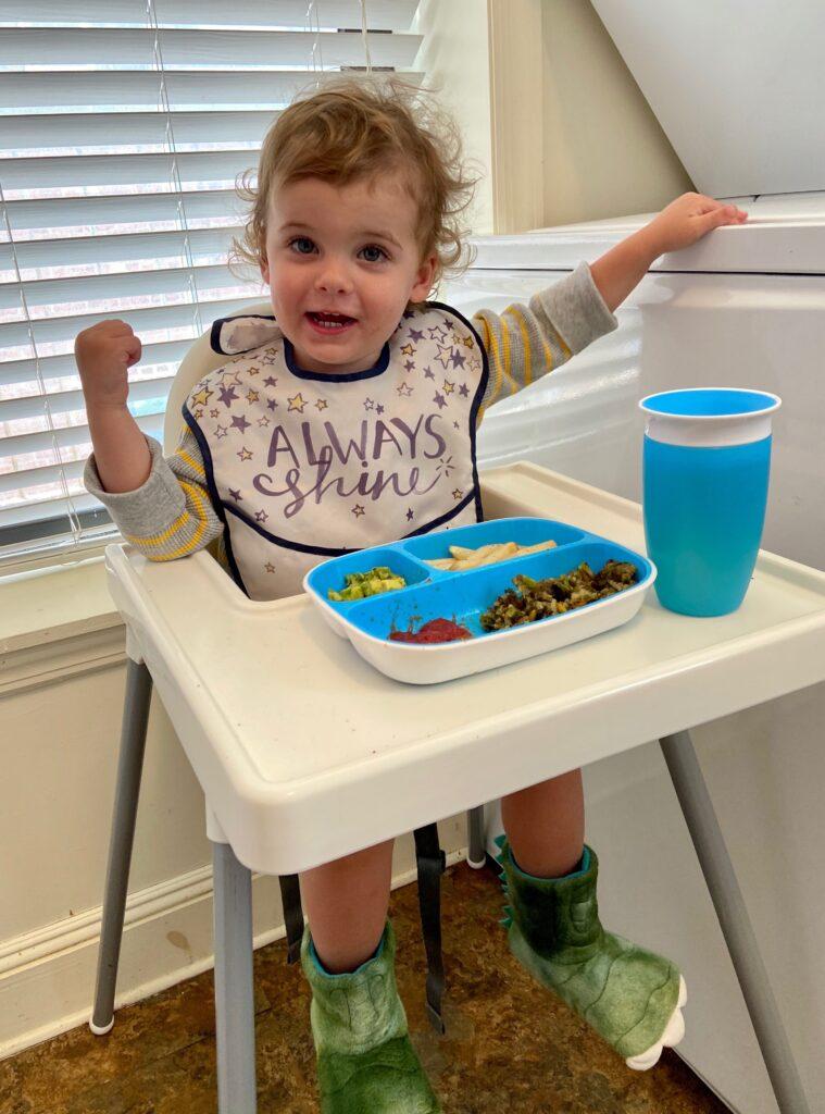 skyler eating dinner two years old