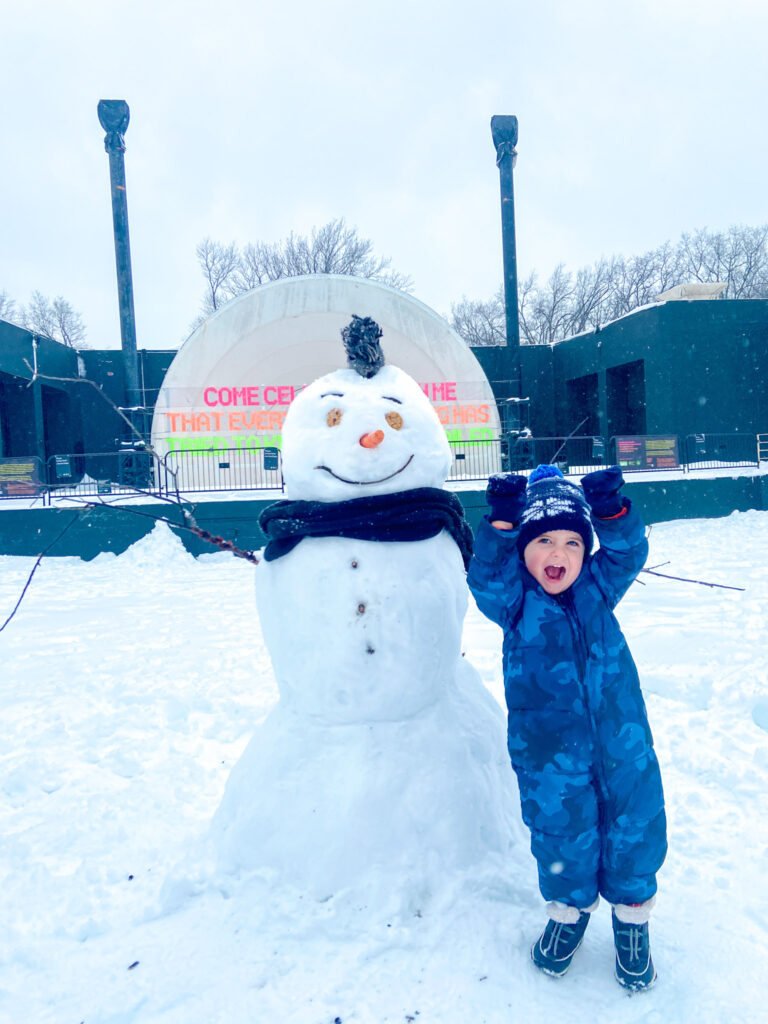 Skyler with snowman 2021