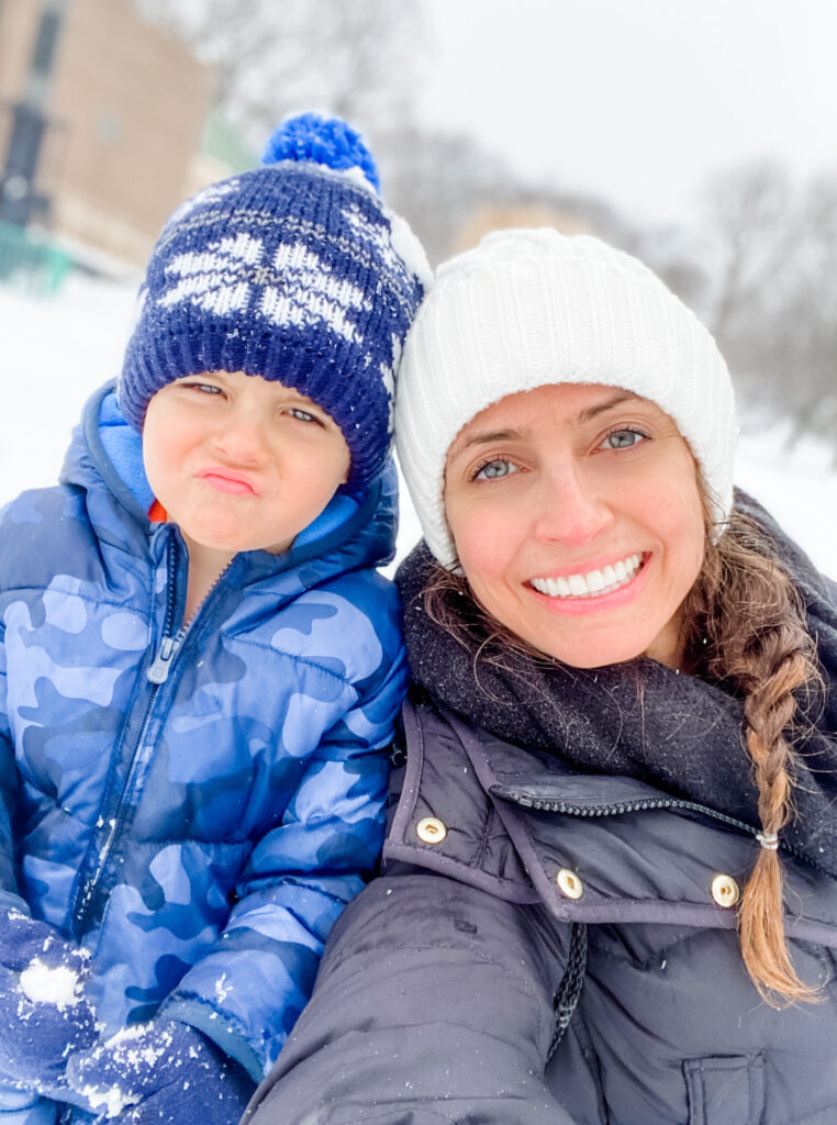 Skyler and Heather in the snow at the park