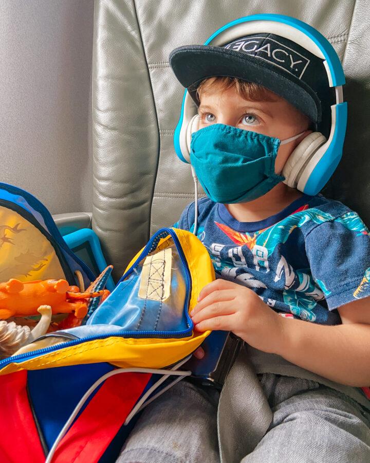 skyler on airplane 3 years old